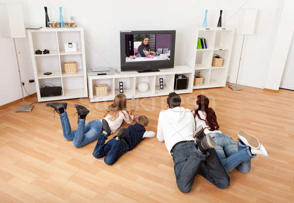Stock fotó: Young family watching TV at home