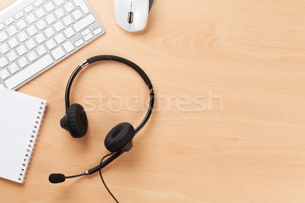 Stock fotó: Office desk with headset. Call center support
